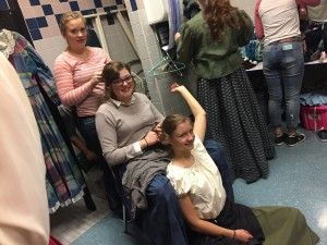 With a 90+ cast, hair trains like this became common in the women's dressing room.  Photo Cred: Maddison Tenney