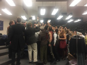 The cast getting ready for their first performance, cheering on their fellow cast members to get their energy up.  Photo Cred: Maddison Tenney